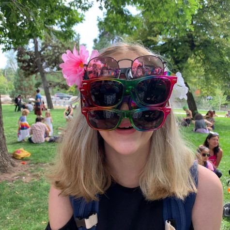 A Boulder High student wears 4 pairs of sunglasses at pride.