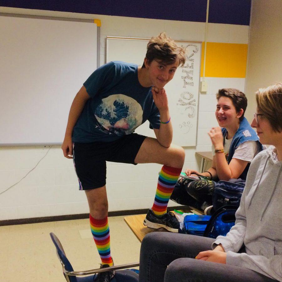 Sophomore Leo Servetar shows off his rainbow socks at a September GSA meeting.