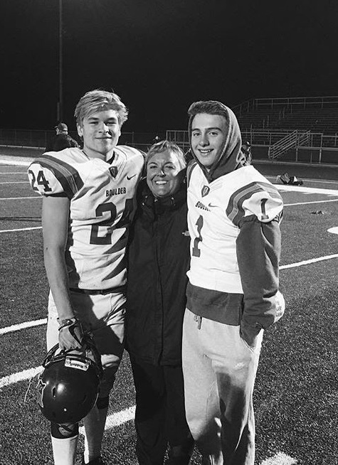 Aberton poses after a game with Daniel Feenstra (left) and Wiley Bennett (right).