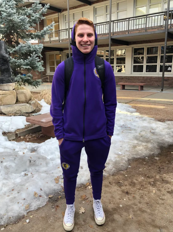 Drake Arthur (junior) is shown here in his purple sweatsuit, wearing it with a smile. Photo by Amanda Reader.