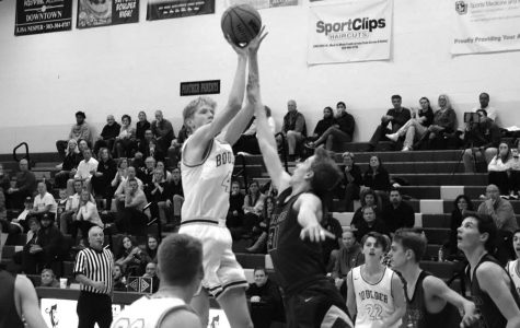 Senior Pete Boyle rises above the opposition defense in a convincing 76-68 win over Chatfield High School on Dec. 2. Photo courtesy of Elijah Boykoff.