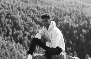 Senior Metkel Tewelde poses for a photo in the Colorado Mountains.