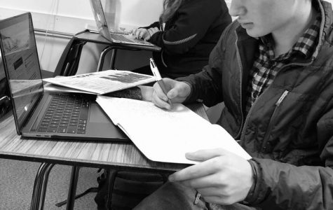 Students like Joe Mulligan start to struggle to stay on top of their work during second semester. However, it's important that he stays on track otherwise he can fall behind and fail which could make colleges not accept him. Photo by Bryce Myers.