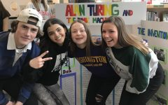 Sophomores Andres Persson Maya Ketterhagen, Natalie Hill and Erika Johnson infront of their National History Day exhibit