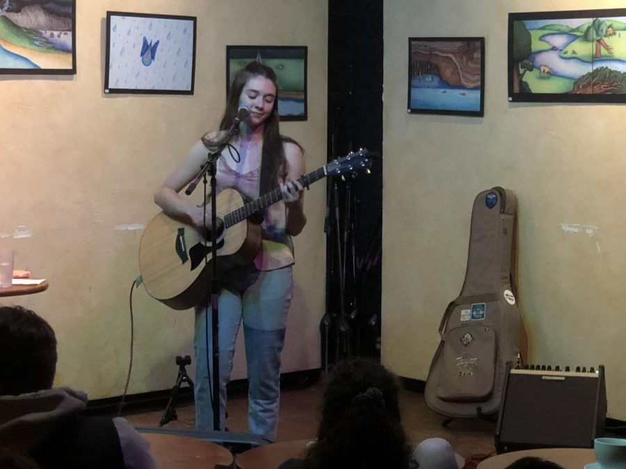 Boulder High sophomore Novella Spielman sings an original song in front of a captivated group of listeners at the Laughing Goat.