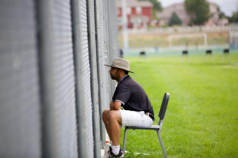 Head Coach Nick Salazar intently watches a match. He guided the Boulder High varsity tennis team to a 7-2 record this season and a chance for players to compete in Friday's state match.