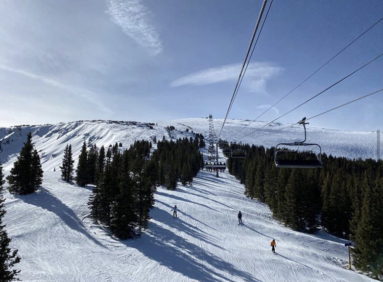 Skiers cruise down the slopes at Crested Butte Mountain Resort.
