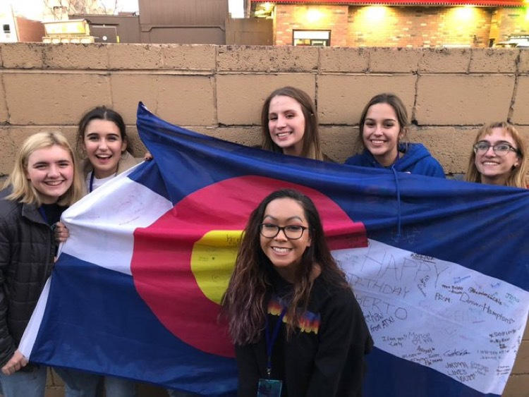 Myself and the friends that I made at a concert in 2018, including Ella Myers (middle, behind flag) and Iman Moaddeli (far right).