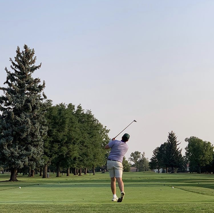 Jack Dooley (12) tees off at a varsity league meet at the Olde Course in Loveland, CO.