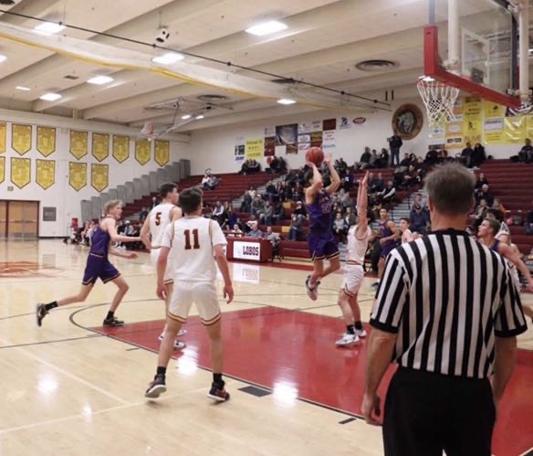 Conner Reagan (12) pulls up for a jumper during a matchup against Rock Canyon last season.