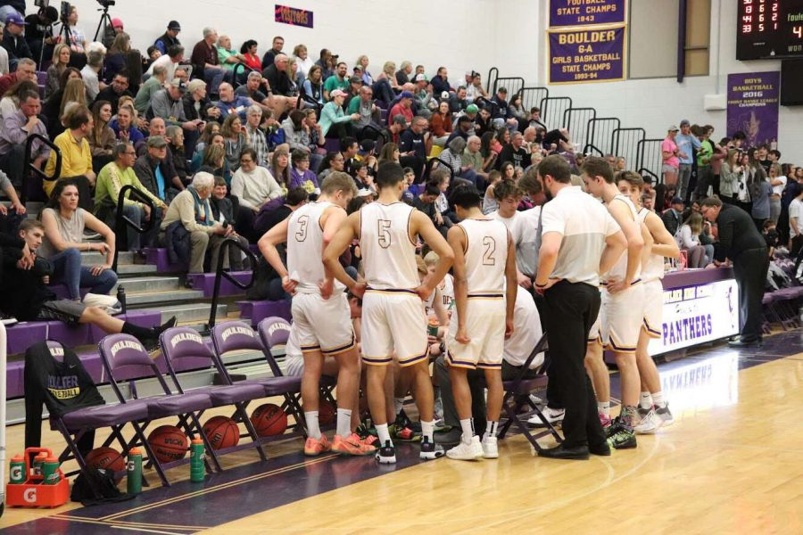 Boulder High Basketball's Varsity Boys team quickly huddles during a game last year. They've been hitting the gym these past few weeks in preparation for the 2021 season.