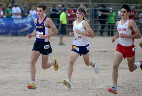 Lukas Haug, left, looks towards the finish line at the Colorado State Cross Country meet on October 17.