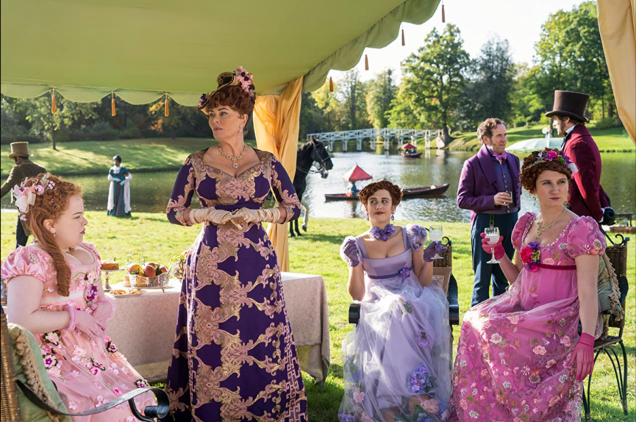 With auburn hair and colorful dresses, the Featheringtons embody the extravagance of the time period.