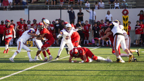 With Boulder High closely trailing Fairview, Boulder makes one of its 70 tackles in the game.
