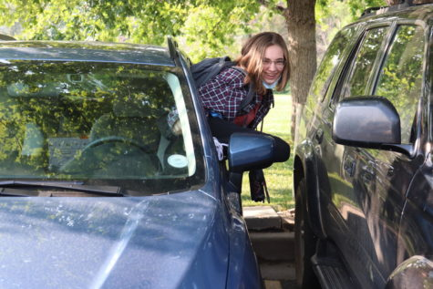 Annika Bjorklund 22 climbs out her window at the start of the school day to avoid a fist fight with the car adjacent to her.